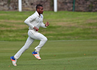 Bollington fast bowler Dario Searle runs in