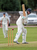 Bollington batsman watches the ball pass his stumps